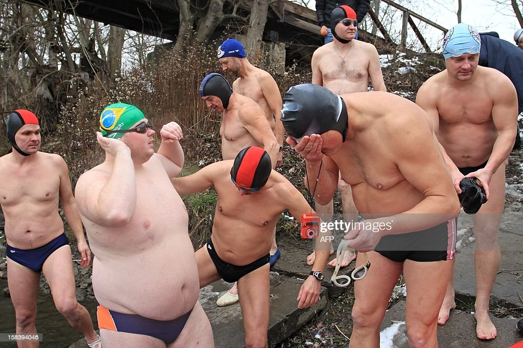 Winter swimmers prepare to swim in the river Thaya near the border to Austria near Breclav, Czech Republic on December 15, 2012. Winter swimmers celebrated the entry of the Czech Republic to the Schengen area on December 21, 2007 and commemorated the victims shot by soldiers in crossing the border to Austria under communism.