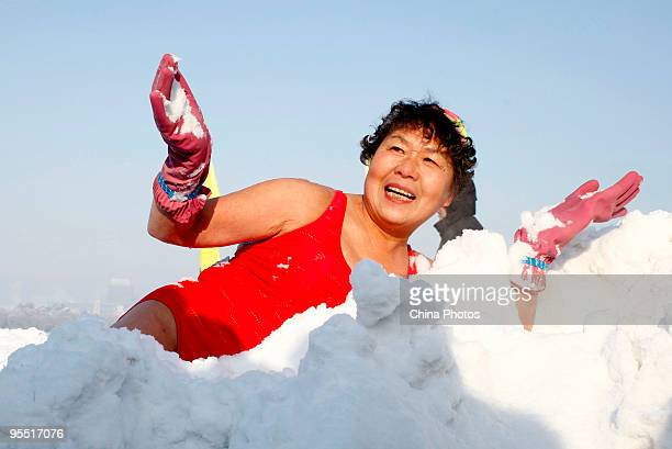 A winter swimming lover poses in snow during New Year celebrations at the Nanhu Park on January 1 2010 in Changchun of Jilin Province China Chinese...