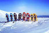 Winter trekking in the mountains. Snowshoes stand in the snow.