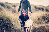 Winter walk on the beach with the dog