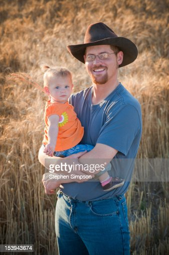 Winter wheat farmer in field with is daughter : Stock Photo