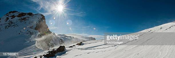 Winter wilderness snow summit sunburst Toubkal Atlas mountains Morocco panorama