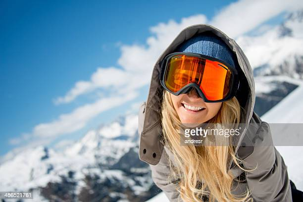 Winter woman with ski goggles