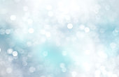 Winter white blue glittering xmas background.Snowy backdrop.
