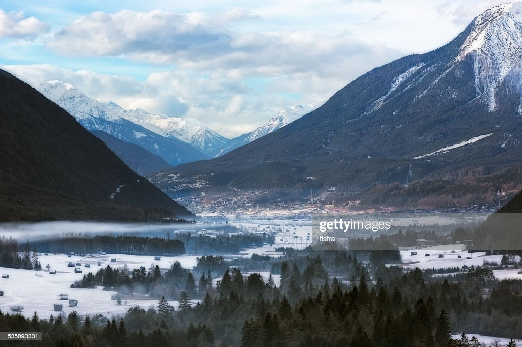Wintery valley in Tirol, Austrian Alps : Bildbanksbilder