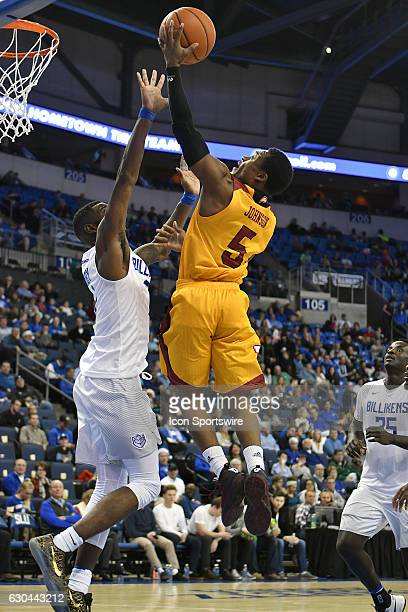 Winthrop guard Keon Johnson puts up a shot over Saint Louis Billikens guard Davell Roby during a nonconference men's basketball game between the...