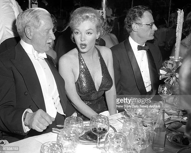 Winthrop W Aldrich former United States ambassador to England engages Marilyn Monroe in animated conversation during the 'April in Paris' ball at...