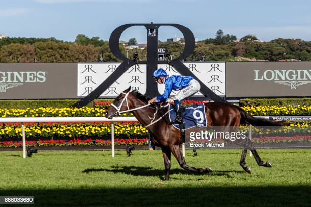Winx and jockey Hugh Bowman cross the line to win the Queen Elizabeth Stakes at Royal Randwick Racecourse on April 8 2017 in Sydney Australia