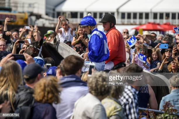 Winx ridden by Hugh Bowman returns after winning the Seppelt Turnbull Stakes at Flemington Racecourse on October 07 2017 in Flemington Australia