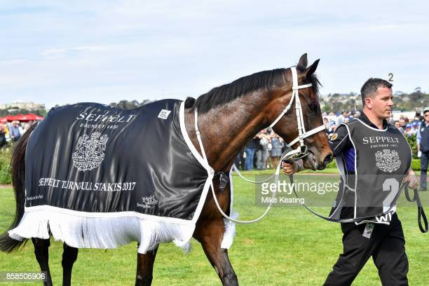 Winx with strapper Umut Oden after winning the Seppelt Turnbull Stakes at Flemington Racecourse on October 07 2017 in Flemington Australia
