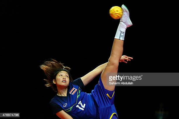 Wiphada Chitphuan of Thailand serves during the sepaktakraw women's regu semifinals match between Thailand and Vietnam at the Expo Hall 1 during the...