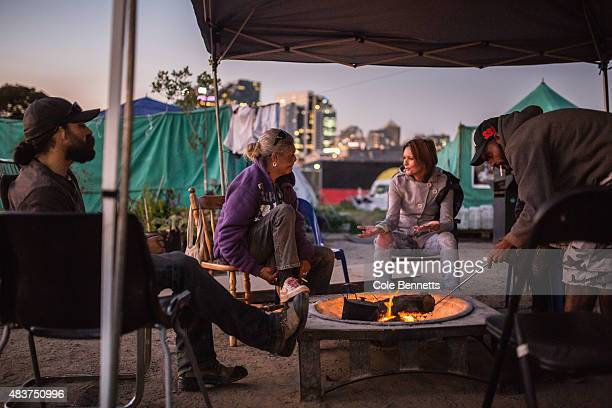 Wiradjuri Elder Aunty Jenny Monro speaks to a Redfern Local who has come to offer her support in daily contributions of food at the tent embassy in...