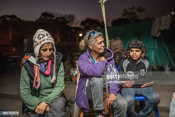 Wiradjuri Elder Aunty Jenny Munro sits around the fire with residents and children connected of the tent embassy in Redfern on August 9 2015 in...
