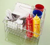 Wire basket,  condiments and supplies for picnic