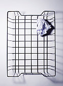 Wire Basket With Crumpled Paper.