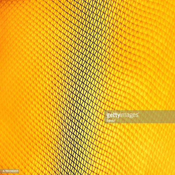 wire mesh on yellow background