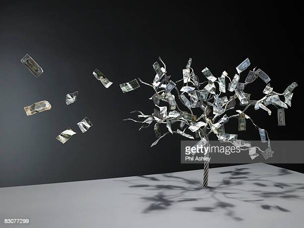 wire money tree with notes flying off
