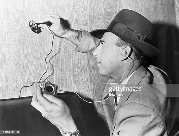 Wire tap device for eavesdropping through a wall door etc a microphone and hearing aid trick The mike picks up sound and the hearing aid magnifies...