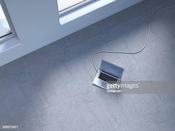 Wired laptop on concrete floor, 3D Rendering