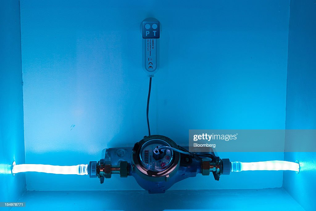 A wireless device for measuring water consumption is seen illuminated in a Portugal Telecom SGPS showroom at the Technology and Innovation conference in Lisbon, Portugal, on Monday, Oct. 29, 2012. 'We believe prices in our domestic market are already low enough,' Portugal Telecom SGPS chief excecutive officer Zeinal Bava said. Photographer: Mario Proenca/Bloomberg via Getty Images