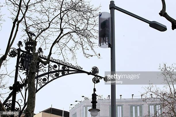 A wireless LED streetlight as known as a 'smart' light right stands beside 19th Century lighting on a street in Barcelona Spain on Wednesday Feb 25...