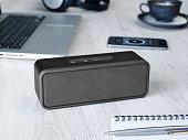 Wireless speaker on a table