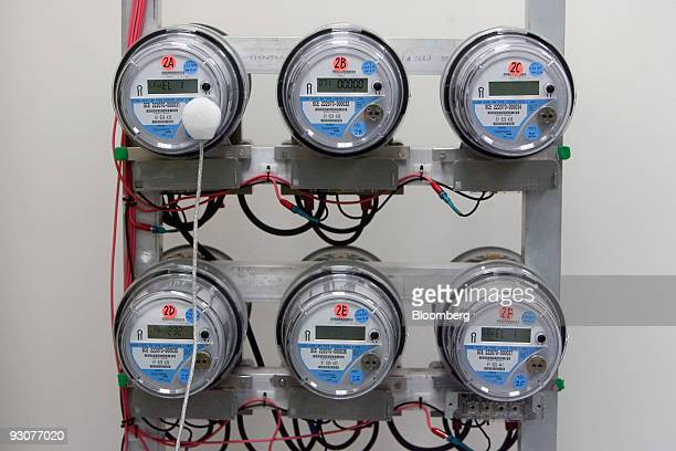 Wires run to 'smart' electric meters during testing in a Southern California Edison meter service center in Westminster California US on Friday Nov...