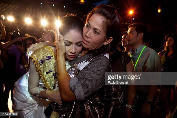 Wirittorn Narapatarapimol a Miss Tiffany contestant cries as she is consoled by a friend after failing to win top prize in the Miss Tiffany beauty...