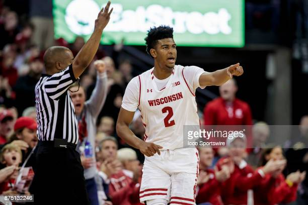 Wisconsin Badger forward Aleem Ford celebrates after making a 3 point basket before half durning an college basketball game between Xavier Musketeers...
