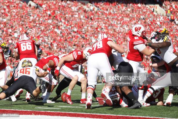 Wisconsin Badger running back Jonathan Taylor fumbles on the 3 yard line during a Big Ten football game between the University of Wisconsin Badgers...