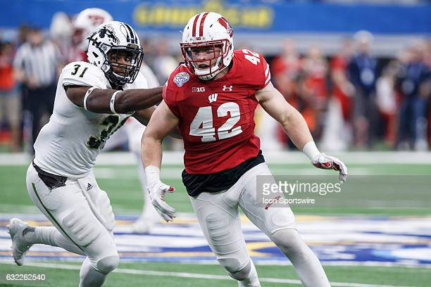 Wisconsin Badgers defensive end TJ Watt gets around the block of Western Michigan Broncos running back Jarvion Franklin during the Cotton Bowl...