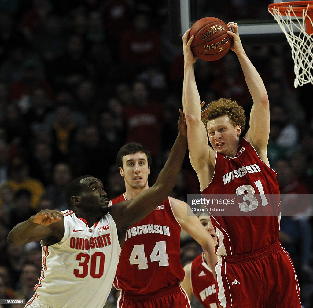 Wisconsin Badgers forward Mike Bruesewitz (31) pulls down a defensive rebound in front of Ohio State Buckeyes forward Evan Ravenel (30) during the first half in the finals of the men's Big Ten basketball tournament at the United Center in Chicago, Illinois, Sunday, March 17, 2013. Buckeyes win, 50-43.