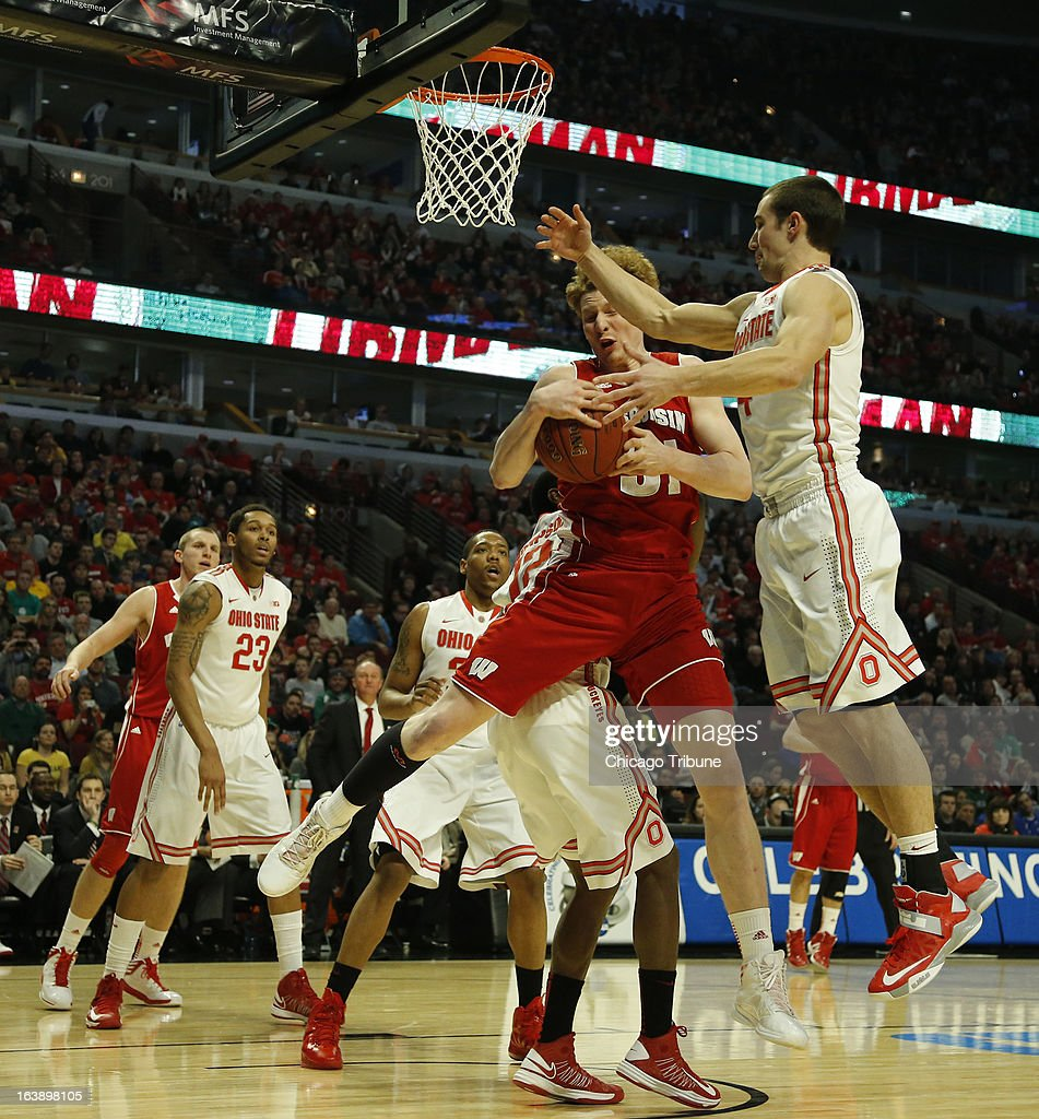 Wisconsin Badgers forward Mike Bruesewitz (31) pulls down an offensive rebound against Ohio State Buckeyes guard Aaron Craft (4) during the first half in the finals of the men's Big Ten basketball tournament at the United Center in Chicago, Illinois, Sunday, March 17, 2013. Buckeyes win, 50-43.