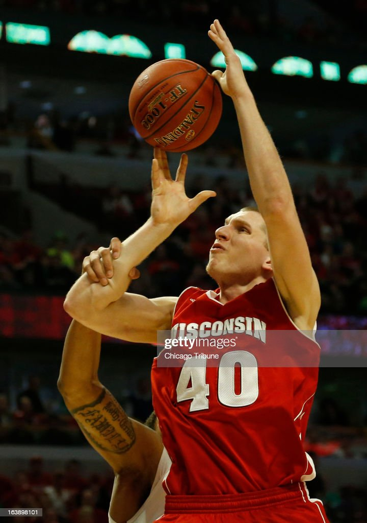 Wisconsin Badgers forward/center Jared Berggren (40) is fouled by Ohio State Buckeyes center Amir Williams (23) during the first half in the finals of the men's Big Ten basketball tournament at the United Center in Chicago, Illinois, Sunday, March 17, 2013. Buckeyes win, 50-43.
