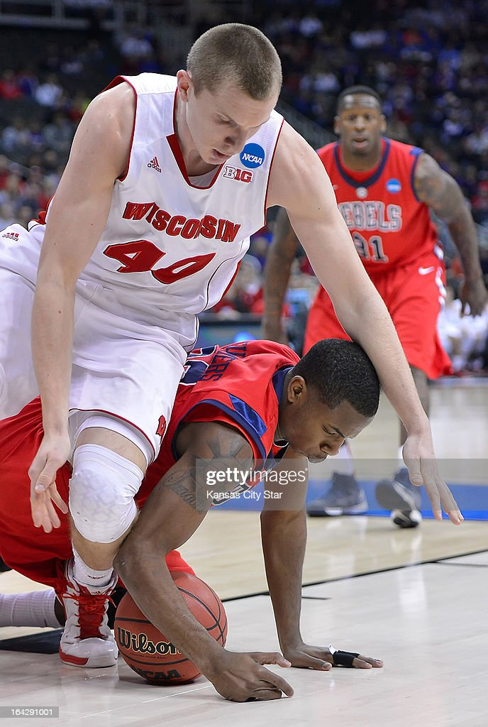 Wisconsin Badgers forward/center Jared Berggren (40) scrambles for a loose ball with Mississippi Rebels guard Jarvis Summers (32) in the first half during NCAA second-round men's basketball tournament action, Friday, March 22, 2013, at the Sprint Center in Kansas City, Missouri.