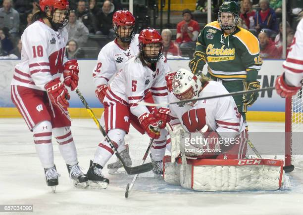 Wisconsin Badgers goalie AnnRenee Desbiens covers the puck during the Women's Division 1 Hockey Championship between the Wisconsin Badgers and the...