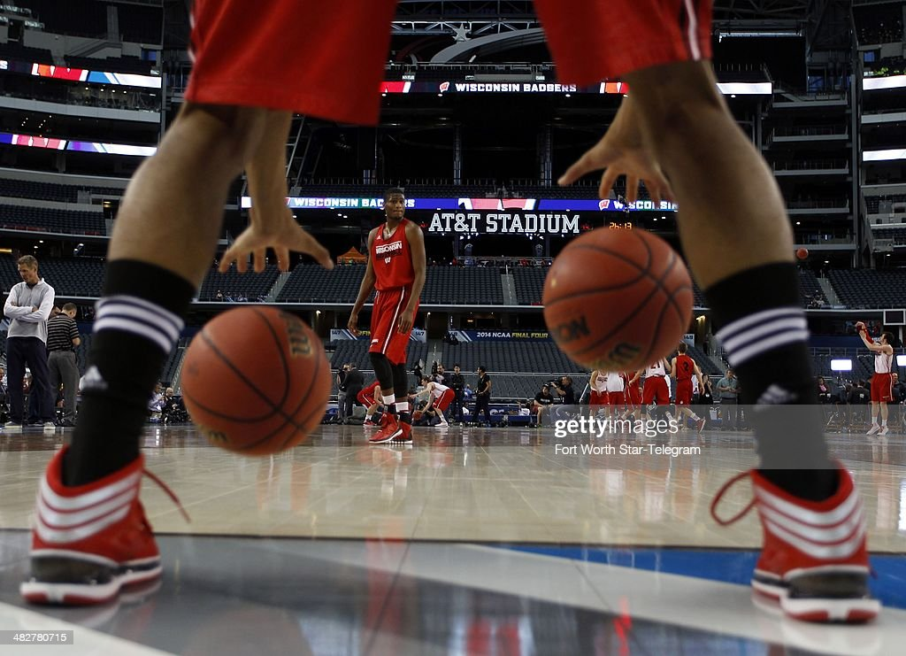 Wisconsin Badgers guard Riley Dearring walks across the court as guard Jordan Hill does a ball drill in preparation for the NCAA Final Four at ATT...