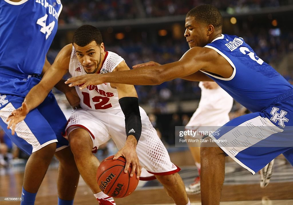 Wisconsin Badgers guard Traevon Jackson drives on Kentucky Wildcats guard Aaron Harrison during the second half as the Kentucky Wildcats faced the...