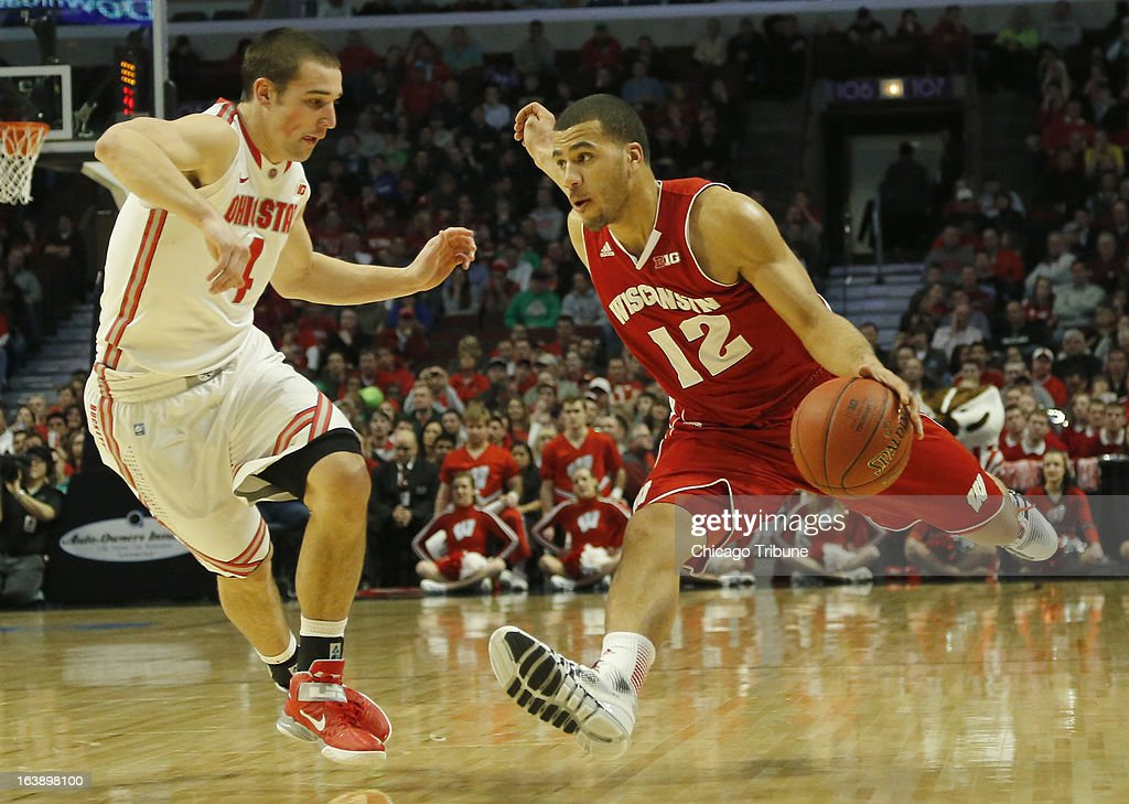 Wisconsin Badgers guard Traevon Jackson (12) drives towards the basket against Ohio State Buckeyes guard Aaron Craft (4) during the first half in the finals of the men's Big Ten basketball tournament at the United Center in Chicago, Illinois, Sunday, March 17, 2013. Buckeyes win, 50-43.