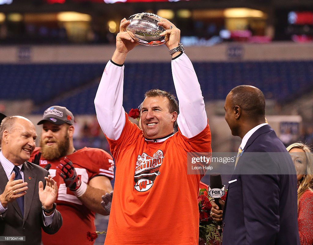 Wisconsin Badgers head coach Bret Bielema celebrates the Big Ten Championship holding the Amos Alonzo Stagg Championship Trophy after defeating the Nebraska Cornhuskers 70-31 at Lucas Oil Stadium on December 1, 2012 in Indianapolis, Indiana.