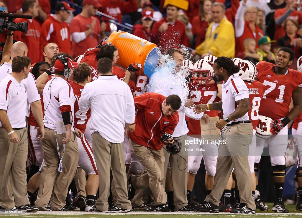 Wisconsin Badgers head coach <a gi-track='captionPersonalityLinkClicked' href=/galleries/search?phrase=Bret+Bielema&family=editorial&specificpeople=818586 ng-click='$event.stopPropagation()'>Bret Bielema</a> is dousted with Gatorade after winning the Big Ten Championship against the Nebraska Cornhuskers at Lucas Oil Stadium on December 1, 2012 in Indianapolis, Indiana. The Badgers defeated the Cornhuskers 70-31
