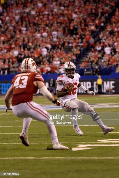 Wisconsin Badgers linebacker Ryan Connelly tracks down Ohio State Buckeyes quarterback JT Barrett during the Big Ten Championship Game between the...