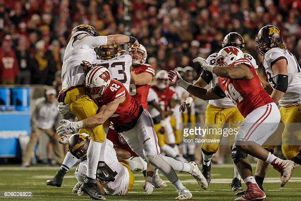 Wisconsin Badgers outside linebacker TJ Watt gets pressure on Minnesota Golden Gophers quarterback Mitch Leidner durning an NCAA Football game...