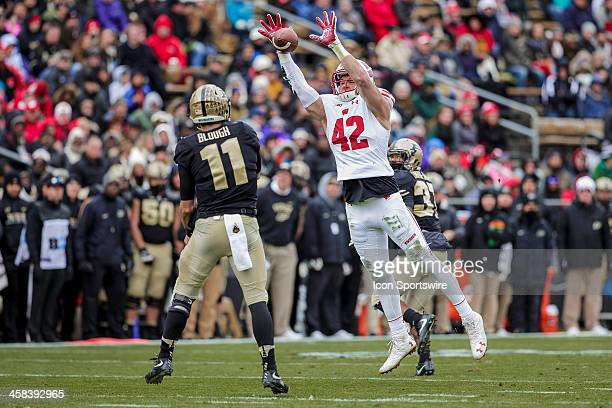 Wisconsin Badgers outside linebacker TJ Watt picks off Purdue quarterback David Blough and returns it a touchdown during an NCAA football game...