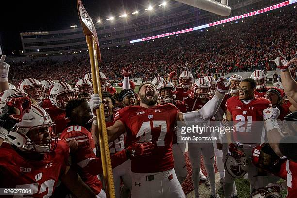 Wisconsin Badgers outside linebacker Vince Biegel celebrates after chopping down the goal post with Paul Bunyan's Axe after an NCAA Football game...