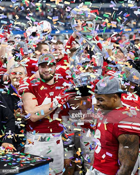 Wisconsin Badgers players including linebacker Vince Biegel celebrate with the Cotton Bowl trophy during the Cotton Bowl matchup between the Western...