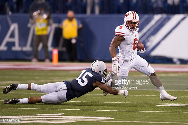 Wisconsin Badgers running back Corey Clement gets by Penn State Nittany Lions cornerback Grant Haley on his way to a 67 yard touchdown run during the...