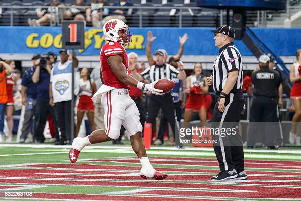 Wisconsin Badgers running back Corey Clement runs in for a touchdown during the Cotton Bowl matchup between the Western Michigan Broncos and the...