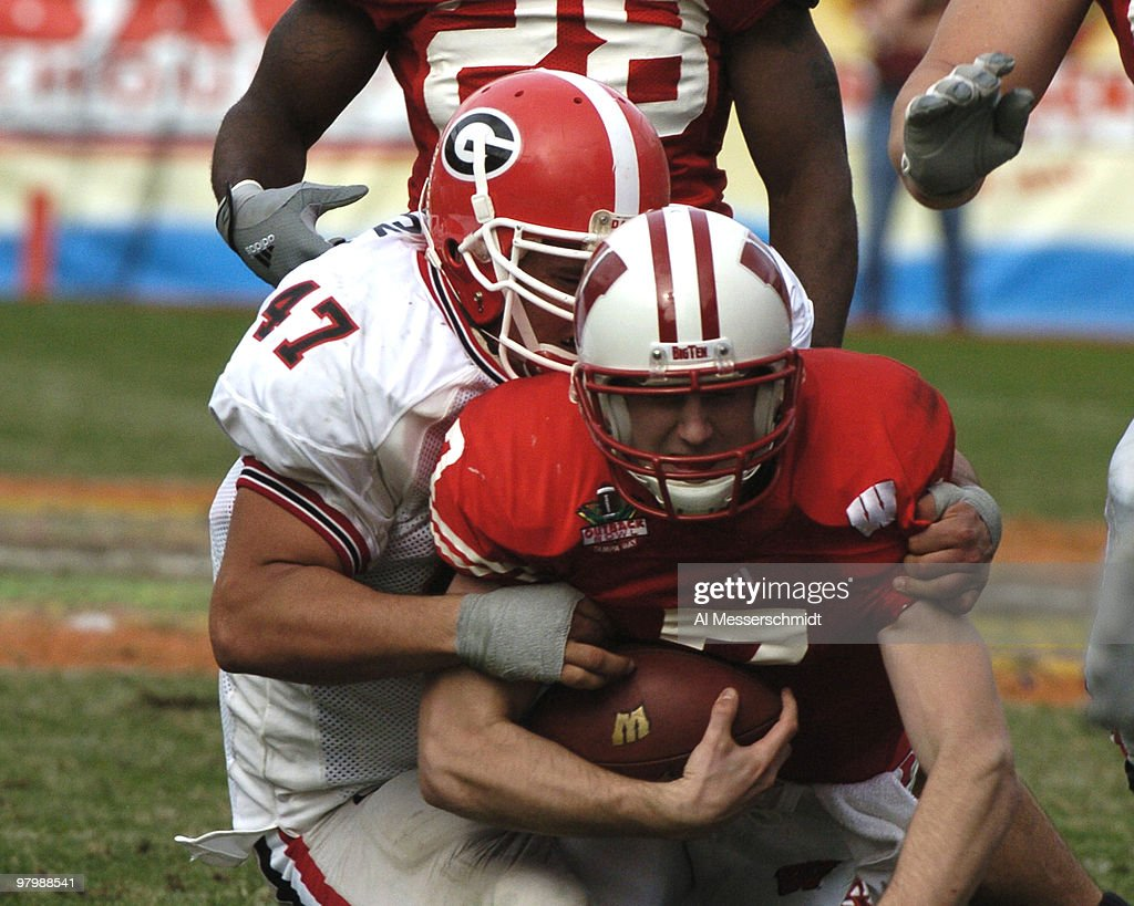 Wisconsin defensive end David Pollack sacks Wisconsin quarterback John Stocco at the 2005 Outback Bowl January 1 2005 at Raymond James Stadium Tampa...