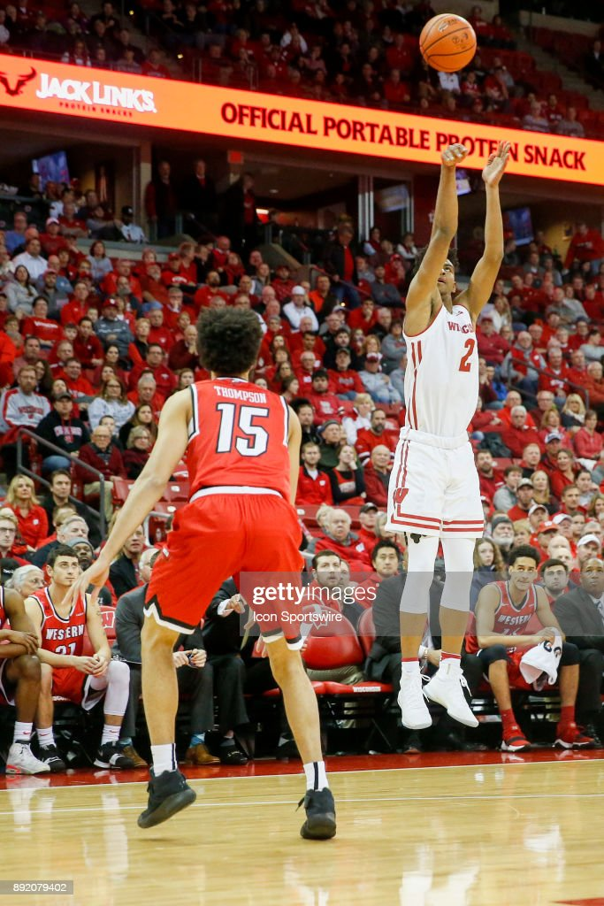 Wisconsin forward Aleem Ford (2) attempts a three point shot over Western Kentucky guard Darius Thompson (15) during a college basketball game between the University of Wisconsin Badgers and the Western Kentucky University Hilltoppers on December 13, 2017 at the Kohl Center in Madison, WI.